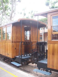 The end of two carriages on Orange Express Majorca.  These are wooden train carriages connected by wrought iron.