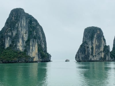 A view of part of Halong Bay that you can see on a Halong Bay day cruise.  You see two large the limestone islands jutting up from the water - you can see these on a Halong Bay 1 day tour.