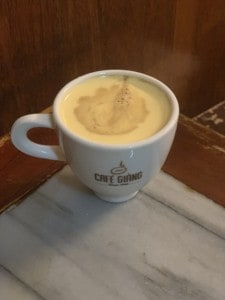 A cup of the Vietnamese egg coffee that you must try during your 4 days in Hanoi.  You can see the creamy yellow consistency of this.