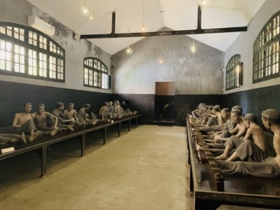 Inside the Maison Centrale prison - you see an reconstruction of the prisoners crowded onto benches