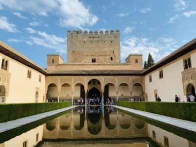 The Patio de los Arrayanes - a narrow stretch of water surrounded with hedges leading up to the King's Palace.  This a beautiful part that you can see when visiting the Alhambra