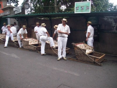 The toboggan ride in Monte.  Traditionally dressed men stand around baskets on runner