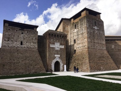 The remains of Rimini's old castle - you can see three sections with a neat green lawn in front