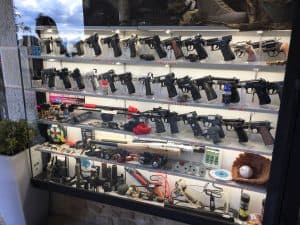 Guns in a glass display in a shop in San Marino