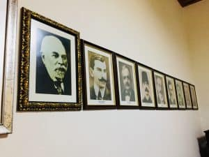 A wall with pictures of the some of the country's leaders