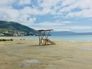 Looking out on the beach in Vlore.  It is a sandy beach.  The only thing you can see on the beach is wooden lookout platform.
