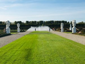 A view of the garden in the Grosser Garten in the Royal Gardens of Herrenhausen in Hannover. You can see a long lawn going down to a fountain