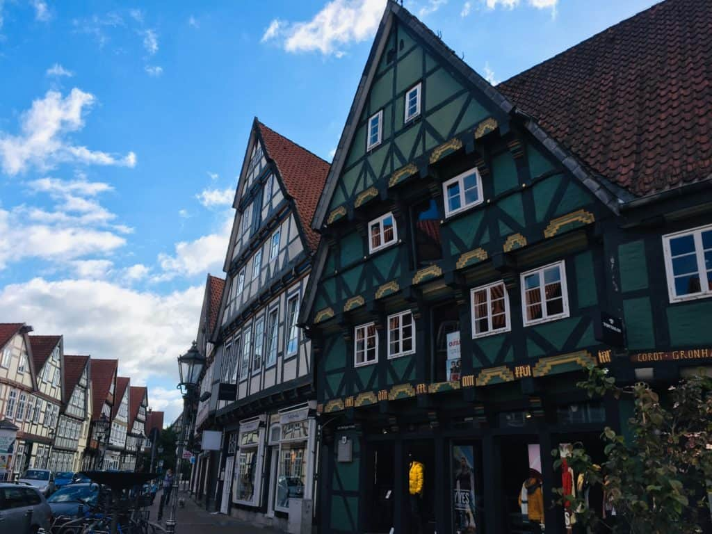 Some of the old medieval buildings in Celle - a place that is easily reachable even if you only have 2 days in Hannover.  You can see two with green and white colours.