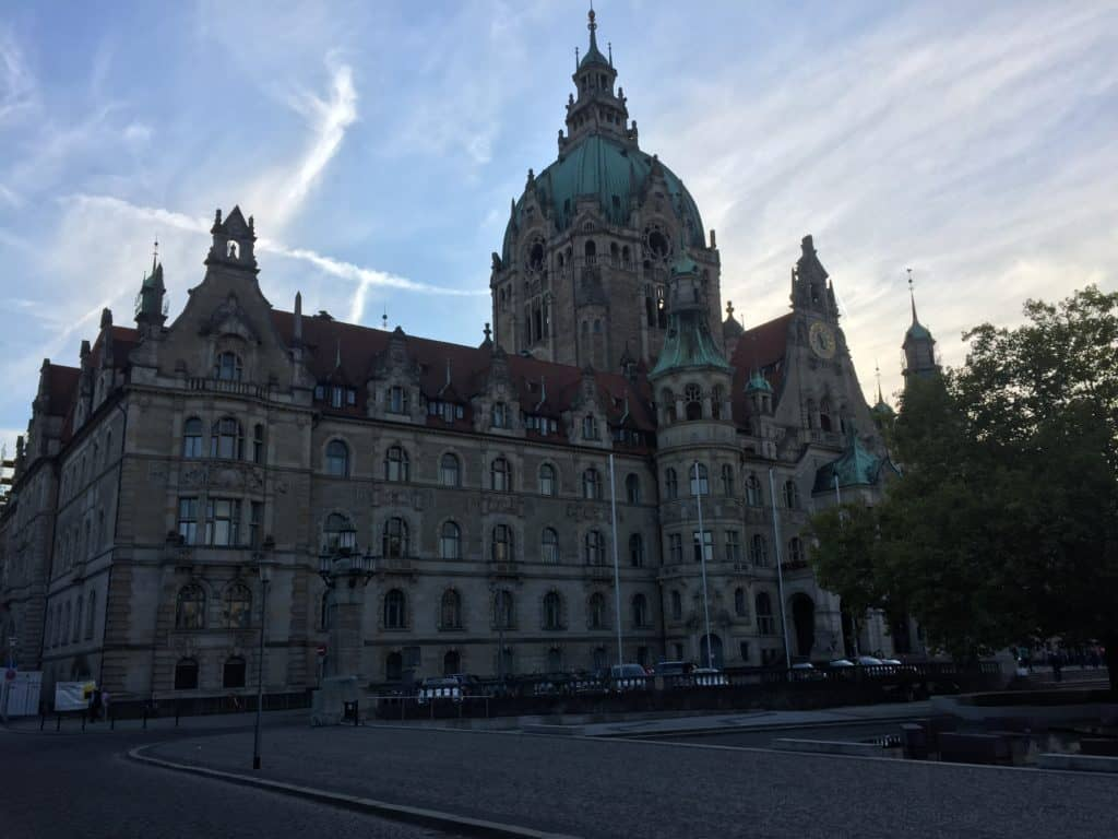 The outside of the Neue Rathaus, somewhere you definitely should visit during your 2 days in Hannover.  It's quite dark as the light is fading.  You can see the ornate structure with its green tower.