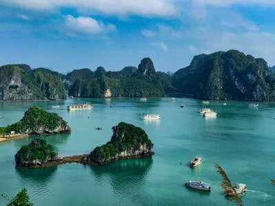 A view over part of Vietnam's Halong Bay and that you can see on a Halong Bay one day cruise.  You can see the limestone islands in the water and cruise ships floating between them