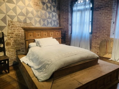 The bed that appeared in the 1968 version of the film, Romeo and Juliet.  This is set on a platform with white linen on top.