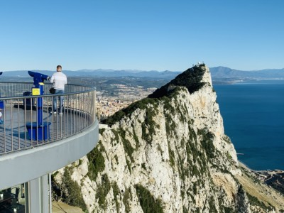 Picture of the viewing station at the top of the Rock of Gibraltar - you can see the rock and look out across to the sea