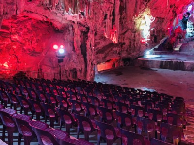 An auditorium in St. Michael's cave, lit up in red