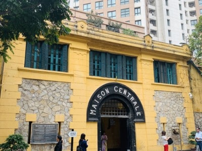 The Maison Centrale or Hao Lo Prison in Hanoi.  This is a yellow building with the name Maison Centrale in an arch above the front door.