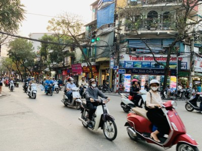 A view of some of the many mopeds speeding through the centre of Hanoi.  It's very busy!