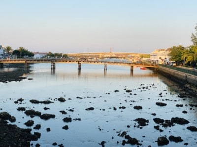 Tavira's river at sunset.  It is low tide so you can see the rocks in the river bed