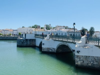 A closer view of Tavira's Roman bridge.  It is white at the top with bare stone underneath