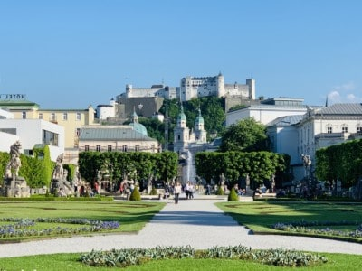 View of the castle in Salzburg from the Mirabell Palace and Gardens.  We visited at the of our Sound of Music tour