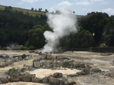 Hot steam rising from the springs in the Vale das Furnas