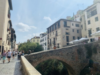 The Carrera del Darro - the cobbled street with a small bridge across the river