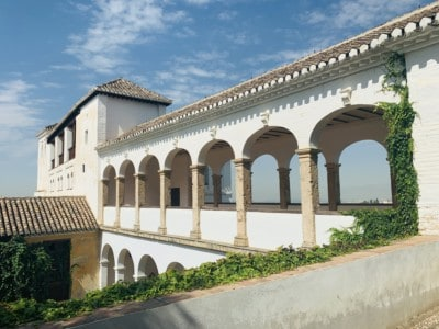 A residence in the Generalife gardens. This is whitewashed with terraces looking out to the outside.