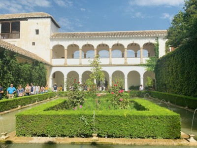 A picture of part of the Generalife gardens with a residence and neat outside gardens.  You can walk here from the Alhambra on your visit to the Alhambra