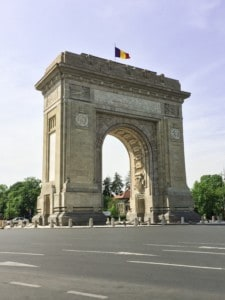 Bucharest's Triumphal Arch sitting in the middle of the road