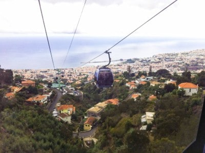 The cable car that runs from Funchal old town to Monte.  You can see the houses and trees below and the sea in the background