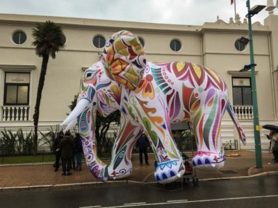 An inflatable elephant on the parade.  It is patterned and coloured