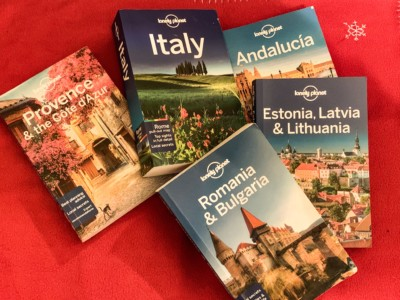 A photo of full Lonely Planet guides - Provence and the Cote D'Azur, Italy, Andalusia, Estonia, Latvia and Lithuania and Romania and Bulgaria.