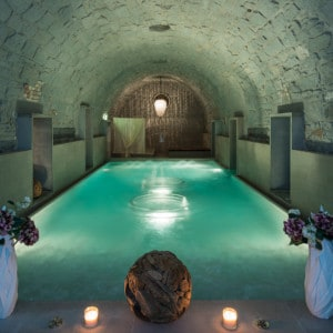 The main pool in the Roman-Irish spa - there is an arched roof and low level lighting