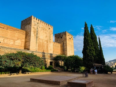 The oldest part of the Alhambra - a fort structure.  You can see cypress trees outside it