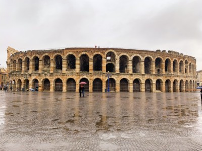 Verona's Arena.  The ground in front is wet from rain.