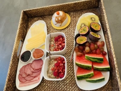 The breakfast tray at the InPatio hotel.  You can see yoghurt and granola, fresh sliced fruit, jams, slices of cheese and locally sourced ham