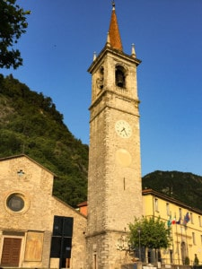 A picture of the small church at the top of the piazza in Varenna.  You can see the tower here with the blue sky in the background.