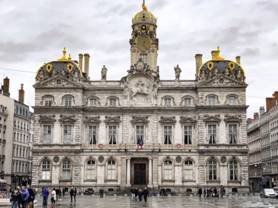 The Hotel de Ville in Place des Terreaux.  This is worth seeing on a weekend in Lyon.  It is a grand building with 3 domes in gold.
