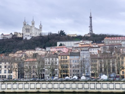 A view of Vieux Lyon the river.  You can see the colourful buildings and the basilica high on the hill