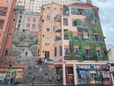 The Mur des Canuts mural.  This is a huge mural covering the entirety of the side of a building.  It is very lifelike and shows buildings, shops and steps.  A visit here is a must on 2 days in Lyon