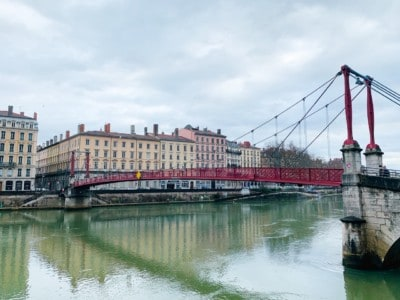 The Passerelle Saint-Georges red bridge.  You can see the bridge spanning the river with buildings in the background