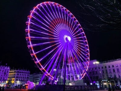 The wheel in Place Bellecour, illuminated at night (it is purple and red here).  If you have a weekend in Lyon in the winter months, you will see this wheel.