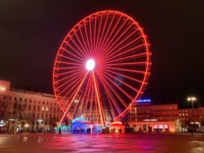 The wheel in Place Bellecour, illuminated at night (it is red here).  If you have a weekend in Lyon in the winter months, you will see this wheel.