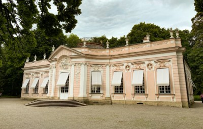 One of the pavilions in the Nymphenburg Palace in Munich.  This is a pretty pale pink colour and is surrounded by trees