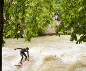 Munich's river with a person surfing on this.