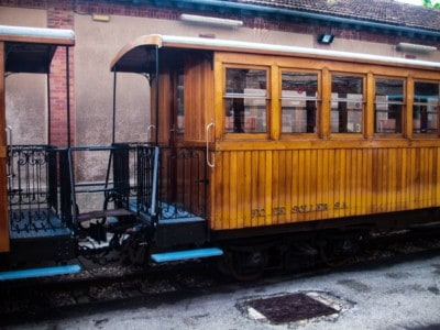 """The """"Orange Express"""" train.  This is an old vintage train."""
