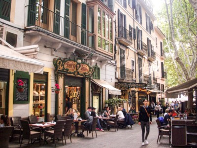 A street in Palma, Majorca with cafes and restaurants lining it.