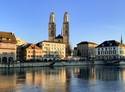 The Limmat river with the Grossmunster church in the background.  The light is fading on the buildings.