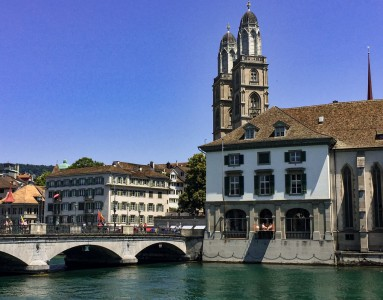 A picture of Zurich's Limmay river with the Grossmunster church