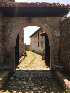 One of the lanes in the castle complex - there is a narrow archway that you walk through and cobbled ground.
