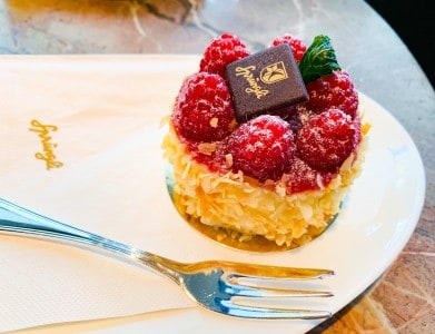 The cake I chose in the Confiserie Sprungli.  It is a small round gateaux with raspberries on the top and nuts around the side.