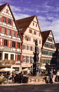 Part of the town square in Tubingen with the timbered buildings and fountain in the middle